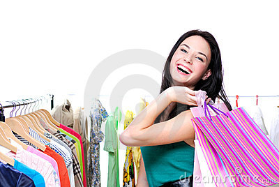 Laughing happy woman out of shopping