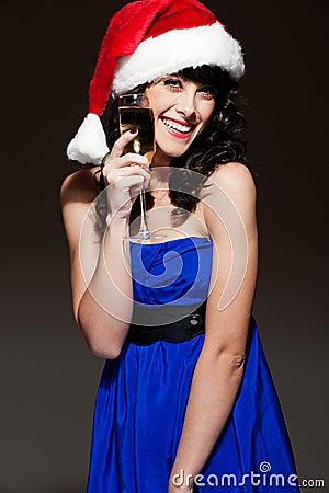 Laughing happy woman in santa hat