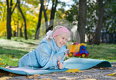 Laughing little girl playing in the park