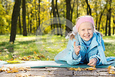 Laughing little girl pointing at the camera