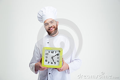 Laughing male chef cook holding wall clock Stock Photo