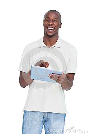 Laughing man using tablet pc