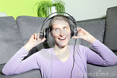 Laughing mature woman listening to music