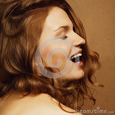 Laughing model with ginger curly hair