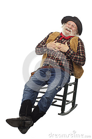 Laughing old cowboy leans back in rocking chair