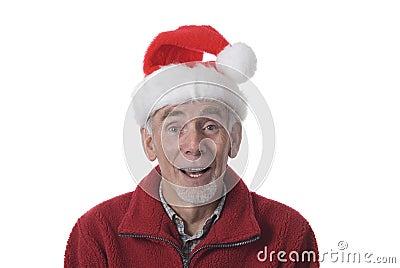 Laughing old man in Santa hat