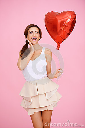 Laughing Playful Woman With A Red Heart Royalty Free Stock Photo - Image: 28736125