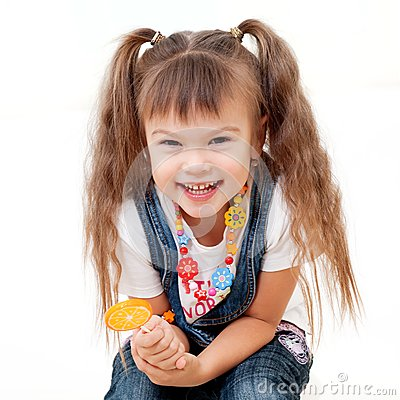 Laughing pretty girl with lollipop
