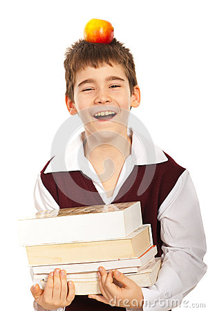Laughing schoolboy with books