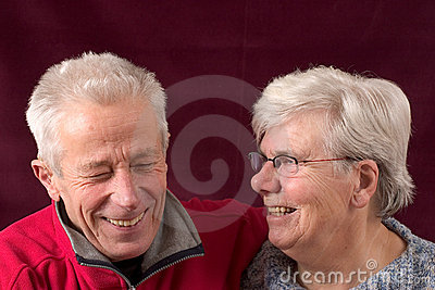 Laughing senior couple