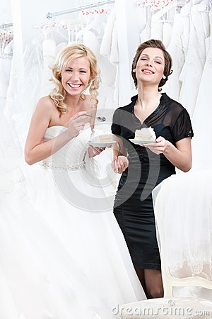 Laughing shop assistant and the bride