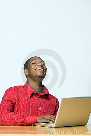 Free Laughing Student On Laptop - Vertical Royalty Free Stock Images - 5490269