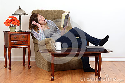 Laughing teen girl with book