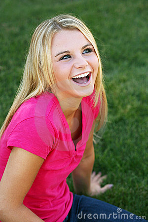 Free Laughing Teen Girl In Grass Royalty Free Stock Images - 16242819