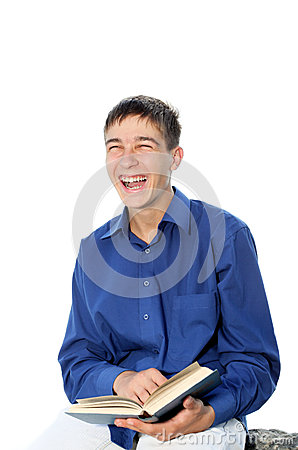 Laughing teenager with book