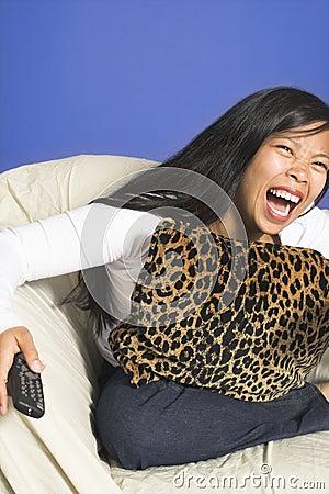 Laughing watching tv