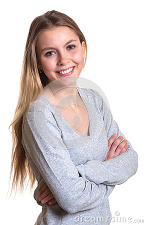 Laughing woman with crossed arms in a grey sweater
