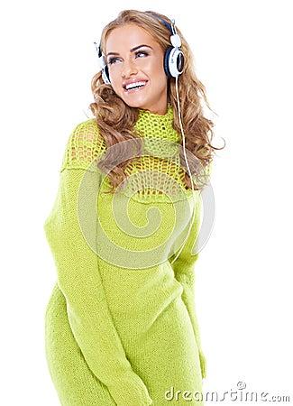 Laughing woman enjoying her music