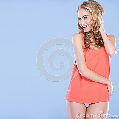 Laughing woman with her hand to her hair