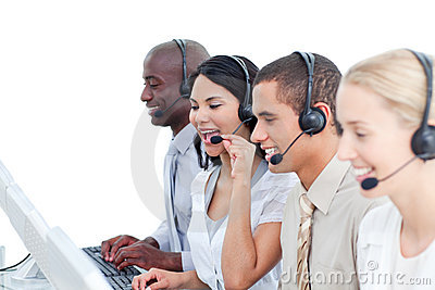 Laughing woman and her team in a call center