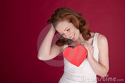 Laughing Woman Holding Heart