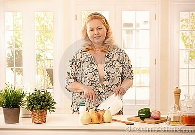 Laughing woman in kitchen