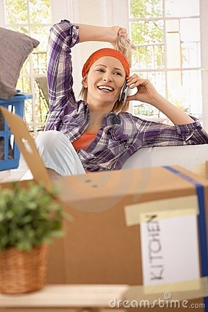 Laughing woman with mobilephone at moving