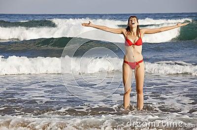 Laughing woman in ocean