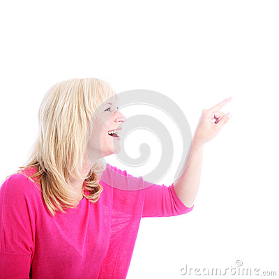 Laughing woman pointing to blank copyspace