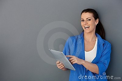 Laughing woman with touchscreen pad