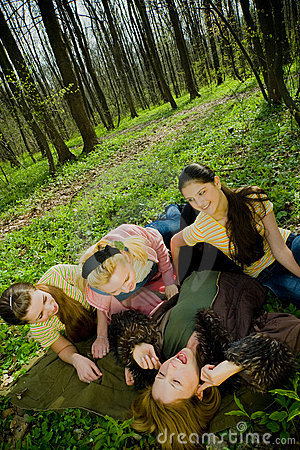 Laughing women in forest