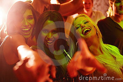Laughing young girls partying at a nightclub