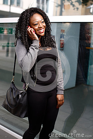 Free Laughing Young Woman Chatting On A Mobile Royalty Free Stock Photography - 45520037
