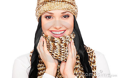 Laughing young woman in hat and scarf