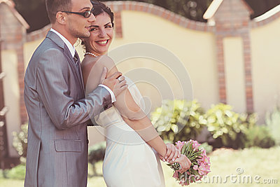 Laughter of a beautiful young bride on her wedding day