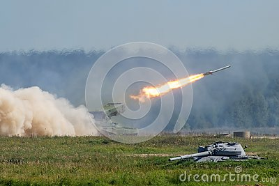 Launching military rockets in the woodlands, war shot defense attack. Stock Photo