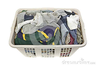 Laundered clothes in plastic hamper