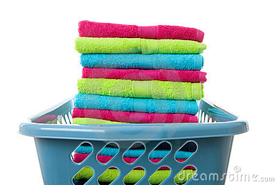 Laundry basket filled with colorful folded towels