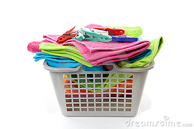 Laundry basket filled with towels and pegs