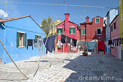 Laundry hangs across the colorful streets of Burano - Venice