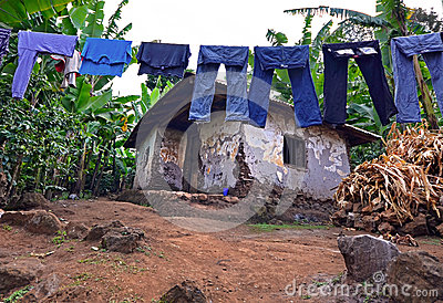 Laundry on a washing lines with mud brick house
