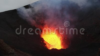 Lava lake in crater of active volcano, eruption red hot lava, gas, ashes, steam. Volcanic natural disaster - view of lava lake in crater of active Tolbachik stock video footage