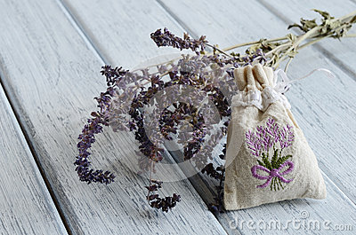 Lavender aroma bag on wooden background