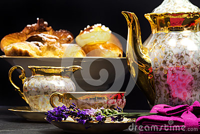 Lavender flavored tea with teapot and sweets