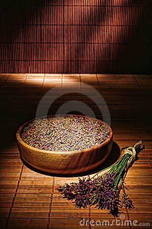 Lavender Flowers and Seeds in Wood Bowl in a Spa