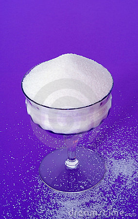 Lavender Glass of Granulated Sugar on a Deep Purple Textured Bac