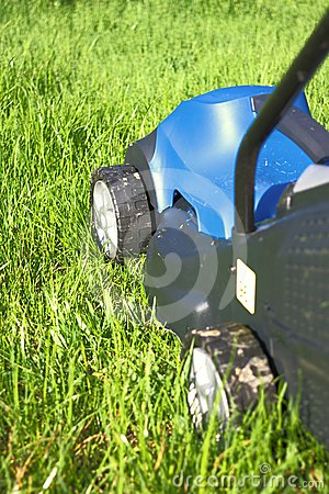 Lawn-mover on fresh grass