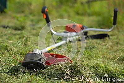 Lawn mower on green grasss