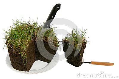 The lawn piece is cut off by a knife