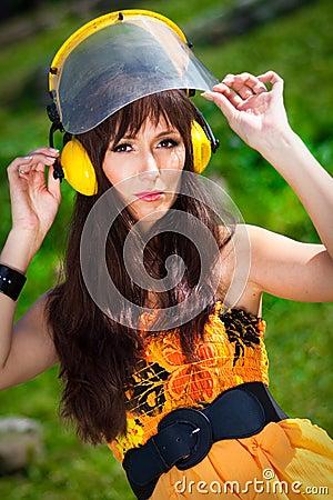 Lawnmower woman in a park